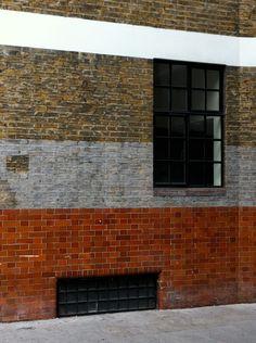 Glazed bricks, painted bricks.