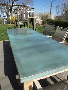Acid stained concrete table. Love the color! Would make a great outdoor prep station