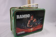 This is a cool retro 1985 Rambo Movie Lunchbox . The paint and printing is in very very good condition with bright colors and little damage and there is peeling paint on the top, only a handful of min
