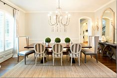 Love the stripe chairs and simple topiaries.