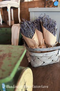 Dried lavender in a basket next to a green kitchen scale
