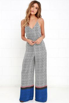 Vacation mode can be a year-round state of mind as long as you have the Speaking in Abstracts Black and White Print Jumpsuit! Woven black and white print fabric shapes a triangle bodice with spaghetti straps that tie below the open back. High-waisted pants fall to a wide cut, with pink, grey, and blue stripes at the hem.