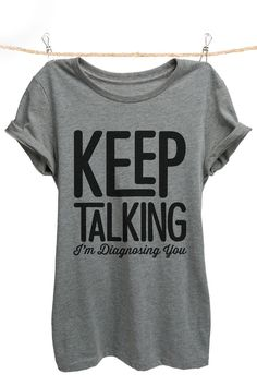"""""""Keep Talking I'm Diagnosing You"""" is featured on a crew neck, short sleeves and a new modern, slim or relaxed fit for effortless style. Printed on quality constructed material, these shirts are perfec"""