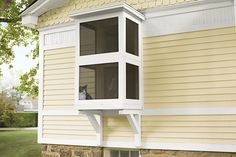 Use basic cedar lumber to create a screened-in patio space that gives cats a breath of fresh air while keeping them close to home