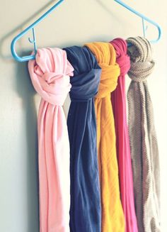 Keep your scarves or tights straight by tying them to a hanger. | 53 Seriously Life-Changing Clothing Organization Tips