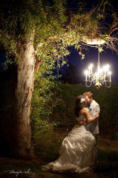 A special moment caught under one of our beautiful chandeliers at The Elegant Barn, a wedding and event venue in Gilbert, AZ.