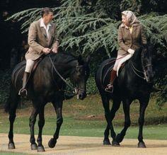 Queen Elizabeth II and Ronald Reagan riding horses together.