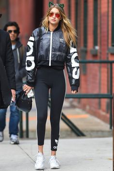 Gigi Hadid wearing Adidas Mystic Moon Crop Track Jacket, Flower Children Only Meow Crown Green, Adidas Stripes Leggings, Elizabeth
