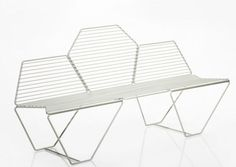 Casamania's Hexagon bench from 2011 in pre-galvanized metal seats three. It's suitable for outdoor use and comes in three colorways.