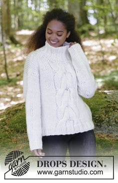Knitted jumper with cables and high collar. Sizes S - XXXL. The piece is worked in DROPS Eskimo. Free knitting pattern by DROPS Design.