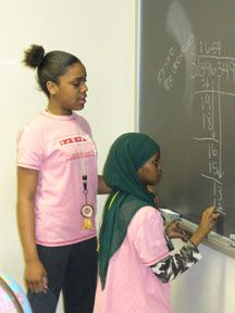GEM program mn info u of m, Girls Excel in Math, here Young Women enjoying long Division