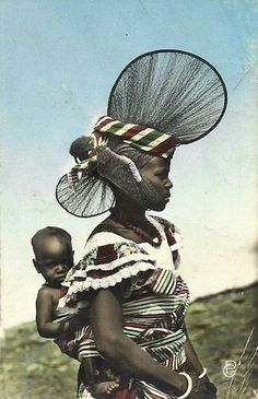 Guinean woman and her baby from Dalaba, French Guinea (modern day Guinea). Scanned from old postcard