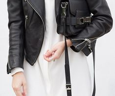 Chic moto jacket paired with a sleek white dress.