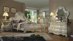 """5 pc York II collection antique white wood finish with intricate carved headboard bedroom set with marble tops. This set includes the Bed, nightstand, dresser, mirror and chest. Queen bed measures 70"""" x 91"""" x 67"""" . Nightstand measures 33"""" x 20"""" x 30"""" H. Dresser measures 68"""" x 20"""" x 38.5"""" H. Mirror measures 53"""" x 3"""" x 48"""" H. Chest measures 42"""" x 21"""" x 56"""" H.  Also available in Cal king and Eastern King at additional co..."""