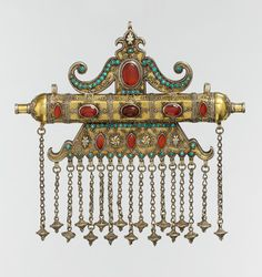 Amulet, late 19th–early 20th century   Attributed to the Karakalpak tribe, present-day Uzbekistan.  Silver, fire gilded with false granulation and twisted wire and beaded wire decoration, gilded and silver appliqués, chain-link and cone-shaped pendants with slightly domed and cabochon-cut carnelians and turquoise beads