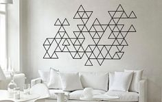 Geometric art makes you realize there's geometry in everything and that it looks pretty great in any interior, whether it's minimalist or bohemian.