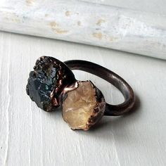 copper ring with topaz and garnet $68.50 from MidwestAlchemy on Etsy