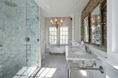 Love this bathroom with the big shower, claw foot tub and exposed brick.