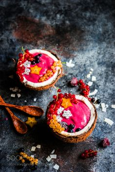 Pink smoothie bowls with berries on rustic background by ehaurylik  IFTTT 500px