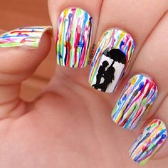 Channel your inner artist by making your nails as your canvass. Use a white base coat and start painting on dripping polish from the base of the nail to the tips. You can also add tiny silhouette figures with an umbrella to protect them from the watercolor rain.
