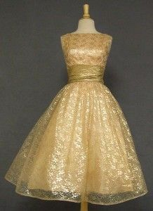A sparkling early 1960's cocktail dress in shimmering gold lace and lame.  available at vintageous.com