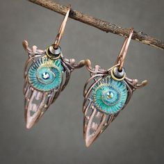 Handmade polymer clay beads were formed using the form of an ammonite fossil. Hand painted in shades of turquoise and highlighted in gold. Swarovski crystals sit in the belly of the bead adding sparkle and shine as you turn your head. Copper filigree is layered beneath the scrumptious handmade beads in the shape of a […]