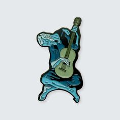 1.68 x 0.95 Soft Enamel Pin Single Posted Rubber Clasp  Inspired by The Old Guitarist by Pablo Picasso  The Old Guitarist is an oil painting by Pablo Picasso created late 1903 – early 1904. It depicts an old, blind, haggard man with threadbare clothing weakly hunched over his guitar, playing in the streets of Barcelona, Spain. It is currently on display in the Art Institute of Chicago as part of the Helen Birch Bartlett Memorial Collection.  At the time of The Old Guitarist's creation…