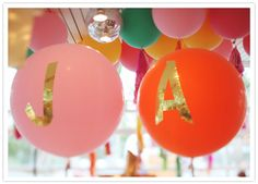 We love the bright bold look of these oversized balloons, embellished with the bride and groom's initials.