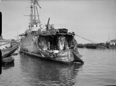 Severe bomb damage to the stern of HMS Delhi. *Note the men standing on the lower decks of the cruiser. This anti aircraft cruiser suffered bomb damage during North African operations in 1942.