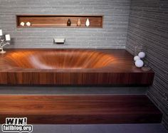 wooden bathtub...gorgeous. not sure it'd be OK to not rot unless it's teak or cedar...