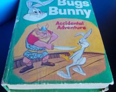 Vintage Bugs Bunny Accidental Adventure Book Copyright Warner Brothers 1969 $10.00 | This 1969 copyright Warner Bros Seven Arts Inc., Bugs Bunny Accidental Adventure by Don Christensen. It has 248 pages with color photos. It's published by Whitman Publishing Company a Big Little Book. It has wear to cover and binding also has red pen on blank front page.