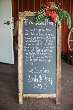 Chalkboard wedding sign idea - winter wedding welcome sign with greenery + pinecone garland {Castleton Events: Design & Planning}