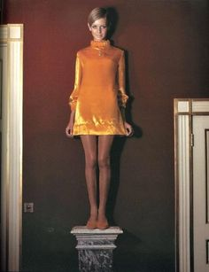 Photographed by Cecil Beaton for Vogue, Twiggy models a Jean Varon mini dress in yellow velvet ............... with hems continuing their journey skywards into 1967