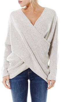 Oversized Wrap sweater. Bun. Bangs straight. Black jeans.
