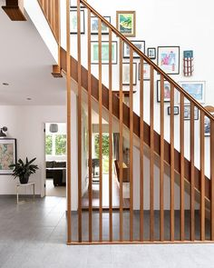 It's the little architectural details that make this remodelled house feel special; an old doorway has been glazed to create a beautiful through-view to the garden while a sapele staircase draws the eye towards the charatcerful and colourful gallery wall. Take a full tour of the house via the link in bio . Photo: Jeremy Phillips . #home #remodel #staircase #window