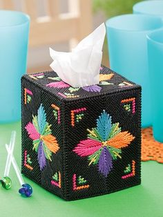 Neon Color Tissue Box Covers.  I used to love plastic canvas - this would be great for something in the Girl Guide Badge Project.