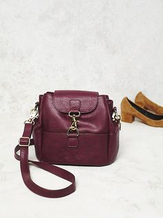 Java Street Crossbody | Vegan leather crossbody bag featuring a flap top closure with buckle detailing. Three inner compartments with multiple pockets. Classic design for easy, everyday wear.