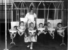 Canvas baby bouncers in a home for children.  1925