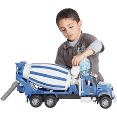 Pour on the excitement with this classic 1:16 scale cement truck that comes with the new Mack Granite cab. Cement mixer actually spins and the doors open and close. The cab also tilts forward for a view of the engine. Movable chute is fed by the drum. Features tread tires; total dimensions are 26in.L x 7in.W x 11in.H.