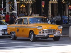 An old classic NYC taxi still running (58th Street & 5th Ave)