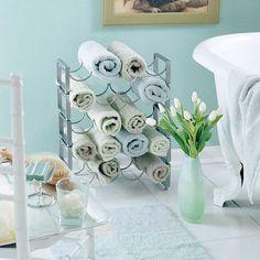 repurposing a wine rack as a towel holder