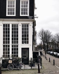 Stunning white building with black accents and windows. Beautiful World, Beautiful Places, Amsterdam Travel, City Photography, City Streets, Adventure Is Out There, Oh The Places You'll Go, Curb Appeal, Interior And Exterior