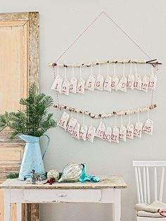 Branches, rope, and some number-stamped muslin bags are all it takes to create this festive countdown-to-Christmas calendar: http://www.bhg.com/christmas/crafts/low-cost-christmas-projects/?socsrc=bhgpin120114hangingcountdownchristmascalendar&page=8