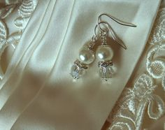 Grace Bridal Pearl & Crystal Earrings Ivory Pearl by ScarlettRose. $12.00, via Etsy.