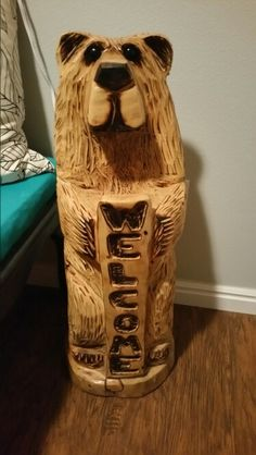 Welcome Bear 2 carved by Bron Bybee