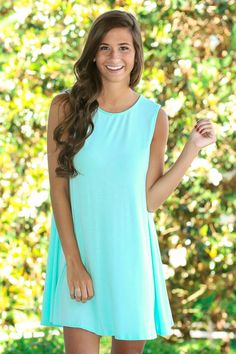 This mint dress is so easy to dress up or dress down- add your own flair by accessorizing with statement shoes and jewelry!
