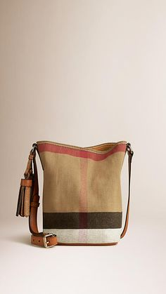 Burberry Saddle Brown The Small Ashby in Canvas Check and Leather - The Ashby in Canvas check and leather with detachable purse pocket. Featuring hand-painted edges and leather tassels, the unstructured bag is inspired by equestrian designs. Discover the women's bags collection at Burberry.com