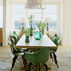 """""""From the ocean view to the classic Eames chair set on new bases, everything about this room screams favorite. Not only is this a great use of the space, but there are so many decorating ideas: I want that chandelier!"""" —Kristen Fielder, assistant photo editor"""