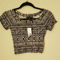 Forever 21 Aztec print crop top NWT Forever 21 tan and black crop top, very soft material, never used *Price firm , bundle & save* Forever 21 Tops Crop Tops