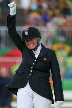 Gold medalist Ann Cathrin Lubbe of Norway celebrates on the podium at the medal ceremony for the  Individual Championship Test -Grade III on day 6 of the Rio 2016 Paralympic Games at  the Olympic Equestrian Centre on September 13, 2016 in Rio de Janeiro, Brazil.